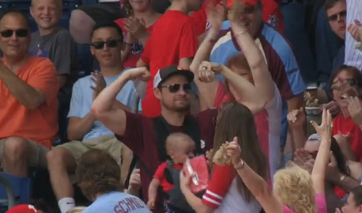 Dad With Baby Strapped To His Chest Barehands Foul Ball Then Flexes On The Crowd