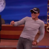 "Jean-Claude Van Damme Recreates The Legendary Dance Scene From ""Kickboxer"" With Conan"