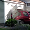 Watch This 91-Year-Old Man Drive Through A Garage Door On Purpose