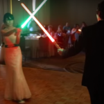 Power Couple Goes All In On Historic Light Saber Duel First Dance