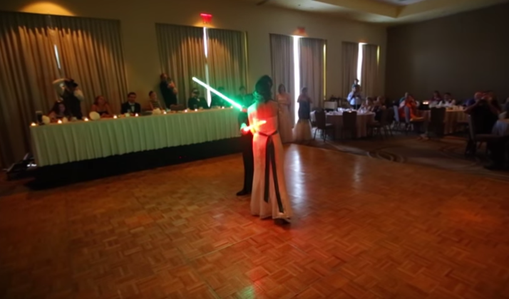 Power Couple Goes All In On Historic Lightsaber Duel First Dance