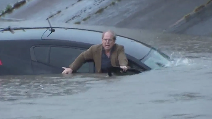 Oblivious Commuter Ever Sure He Should Leave His Car As Houston Flood Waters Submerge It