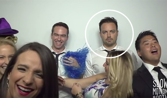 This Beaten-Down 30-Year-Old Man's Slo-Mo Wedding Photo Booth Video Is All Of Us