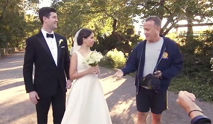 UPDATE: There's Now A Video Of Tom Hanks Crashing The Married Couple's Photoshoot