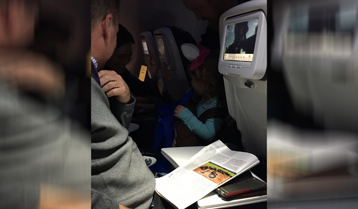 Best Dad Ever Handed Candy Out To Fellow Flight Passenger So His Daughter Could Trick-Or-Treat